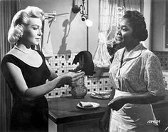 Lana Turner (best crier) and Juanita Moore (best dyer) in 'Imitation of Life' best and brave film about racism and identity.
