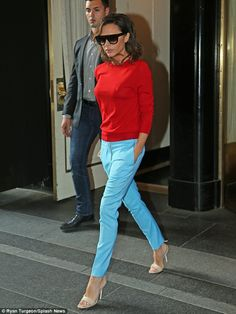 Seeing red: Victoria Beckham got colourful on Wednesday as she stepped out in bold summer brights in NYC