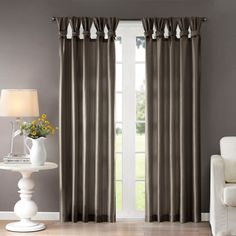 This faux silk curtain panel will add rich texture and sheen to any room in your home. The panel is made from polyester and is conveniently machine washable. Available in two different lengths and a r More