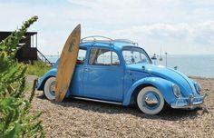 blue vw bug. beach.
