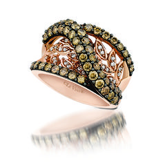 Leaf detailed ring with vanilla and chocolate diamonds in stunning strawberry gold. Marshall Jewelry
