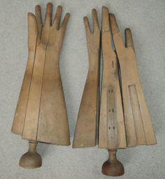 a pair of antique wooden glove holders