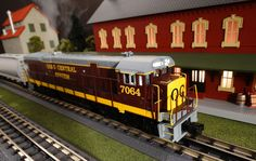 Find It Locally http://mthtrains.com/30-20262-1 Now arriving the 2015 MTH RailKing O Gauge C30-7 . Featured the 2015 Volume 1 RailKing & Premier O gauge Trains Catalog the C30-7 comes in Burlington Northern 30-20259-1, Conrail 202260-1, Norfolk & Western 30-20261-1, and Ohio Central 30-20262-1. The RailKing C30-7 operates on O-31 curves and these 2015 models have a MSRP of $329.95. Ask your MTH Dealer about getting one today.