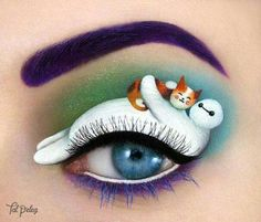 Beautiful and magical makeup paintings on her own eyelids!