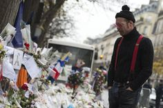 Eagles of Death Metal Visit the Bataclan, Pay Their Respect to Paris Terror Attack Victims   SPIN