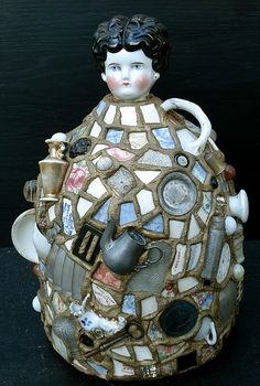 The first memory jugs were made by African Americans for grave adornments.They are mosaic vessels covered in mortar & encrusted with shards, shells & various found objects. They were popular in Victorian times as folk art but the idea is believed to have originated from African mourning vessels as three dimensional scrapbooks. They are fascinating time capsules that link the past to the present as poignant narratives.