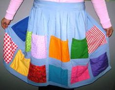 """Pick-pocket lady"" apron – an old fashioned carnival game; the kids ""pick-pocket"" for candy and prizes in the pockets."