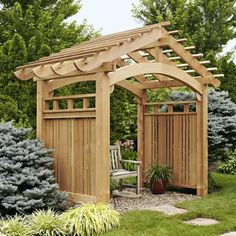 Distinctive architectural details; massive posts and beams, slatted side panels with decorative stiles, arched openings, and a roof that soars to a peak combine to make this arbor a captivating garden addition