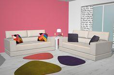 Aquí tenemos colocados estos cómodos sofás ya que como teníamos bastante espacio hemos colocado 2 de la misma medida y en un tapizado claro con lo que hacemos que resalte más el color que hemos puesto de la pared ya que tenemos 2 paredes en este color rosado y las otras 2 en color blanco, encima del sofá tenemos unos cojines diferentes ya que en un sofá están en color gris y en el otro sofá están combinados en unos colores muy vistosos.