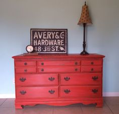 I made DIY chalk paint for this one! I would share the color but I actually got it from the mistinted paint section at Lowe's. www.gingersgirl.etsy.com Red chalk painted furniture.