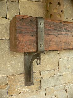 exterior mantle brackets (detail) by Maynard Studios I've been wondering how to hang my RR lumber to use as a shelf.love this idea! La Forge, Rustic Fireplaces, Brick Fireplaces, Blacksmith Projects, Fireplace Wall, Fireplace Mantles, Blacksmithing, Barn Wood, Interior Design Living Room