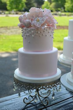 Blush and Silver wedding cakes with sugar peonies.