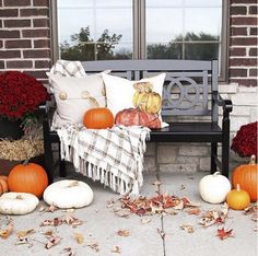 This #instamoment couldn't get any better! This is the perfect perch to watch for trick or treaters.   #MyPotteryBarn #HappyHalloween #FrontPorch