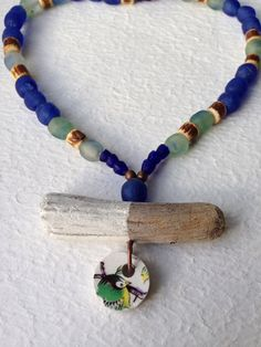 Driftwooden pendant with repurposed China, African recycled glass beads necklace door Trendwondering op Etsy