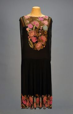 BEADED CHIFFON WRAP DRESS, 1920's. Sleeveless black silk with fanciful floral beadwork in pink, rose, aqua, blue and gold with gold metallic embroidery, wrap back with deep V, scalloped hem. B-40, L-41. (Very minor losses, no under dress) excellent. $1,920.