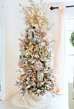 How to trim out your Flocked Christmas Tree with Pink Accents - Classy Clutter