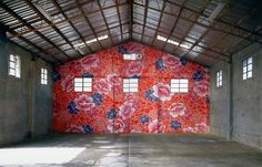 Michael Lin's floral art installations are inspired by traditional Taiwanese textiles. His work is hand-painted on panels that hang in front or on the lobby floor of a museum, gallery, cafe, and other spaces.