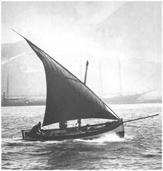 Lateen-rigged felucca.  Saw one of these hanging in the rafters of the Monterey Aquarium.  Sweet boat!