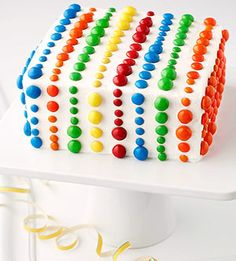 To make this colorful cake, press rows of mini, regular, and peanut M's into the icing in bold patterns.    from parents.com