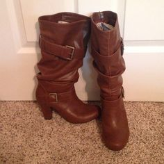 Cognac Slouchy Boots Great pair of slouchy boots for fall. They have 1.5 inch heel, fun buckle detail in both. Was only worn a handful of times. Super comfy, in great condition. Size fits true. There are a few scuff marks on them. On the toe of the left boot and the back of both. (See photos) Price reflects these flaws. Can be modeled upon request. Smoke free home. Mossimo Supply Co Shoes Heeled Boots