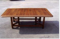 Custom Dining Table in a Farm Style.  Walnut hand worked to an ideal aged patina.    Seats 8 to 10