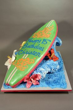 Decorated in buttercream, fondant and gumpaste. Used Lauren Kitchen's method of making the wave. Surfboard Cake, Surf Cake, Luau Birthday Cakes, 50th Birthday, Beach Wedding Cake Toppers, Novelty Cakes, Cupcake Cookies, Cupcakes, Love Cake