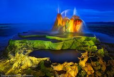 Fly Geyser (or Fly Ranch Geyser) is a a small geothermal geyser that is located approximately 20 miles north of Gerlach, in Washoe County, Nevada. Fly Geyser Nevada, Places Around The World, Around The Worlds, Black Rock Desert, Le Site, Vacation Destinations, Vacation Ideas, Geology, National Geographic