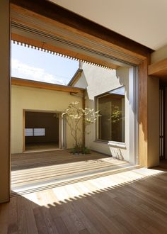 http://www.contemporist.com/2012/02/21/house-in-hinomiya-by-tsc-architects/hh_210212_14/  Contemporist, Hinomiya house by TSC Architects. Sliding doors open.