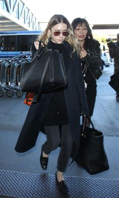 Ashley Olsen goes in minimal in black at LAX Airport #style #fashion #aviatorsunglasses #jeans #therow #mka #celebrity
