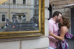 Couple reflected in a mirror at Piazza Trastevere in Rome Italy. Andrea Matone #engagement photographer.