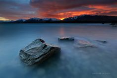 Eye of Mordor by Christian Lim ~ lake tekapo gave us a sunrise to remember, the sun peaks up the mountains giving a faint crepuscular ray. location though is not at the south island but the north island (tongariro national park). always a perfect blue lake,