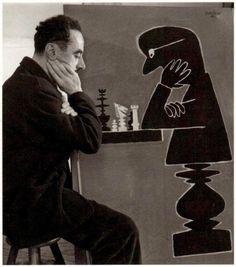 Raymond Savignac playing chess, 1950   by  Robert Doisneau