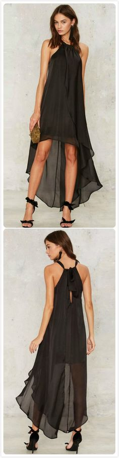 Will you remember the holiday? This chiffon dress detailed with solid color, halter design, asymmetric hem and bow back.