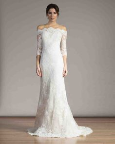 Long-Sleeve Wedding Dresses We Love   Martha Stewart Weddings - If you're covering your arms, consider keeping another area bare. With its off-the-shoulder neckline and three-quarter-length sleeves, this divine design from Liancarlo's Spring 2017 line reveals just the right amount of skin.