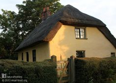 This is a late 17th century 'Mud and Stud' cottage in the beautiful Lincolnshire Wolds of England. You can find Mud and Stud homes in Jamestown, Virginia, USA built there by British colonists. Mud and stud is similar to 'wattle and daub' but the mud (clay, sand and straw) is supported by vertical riven lathes. More at www.naturalhomes.org