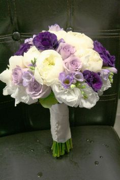 Purple and white peonies - replace the purple with more white, a little pink and some silvery lambs ear.