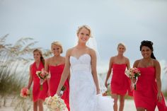 beach wedding with coral bridesmaid dresses