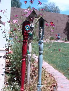 "Baluster birdhouses   Go to local salvage yard to find some great old balusters for very cheap. Then find metal flowers and paint them. Using tin snips cut a roof for each from a 24"" X 24"" decorative tin from Outwater. For the center of the flower use decorative upholstery tacks and paint them too."