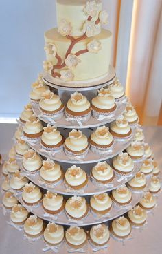 Wedding cupcake tower: splurge on a small ornate cake and then fill out the rest with pretty little cupcakes