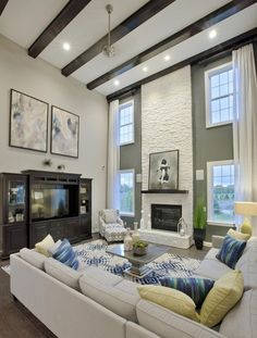 Host a holiday party, with friends and family, in this vast high-vaulted living room perfect for a get-together. From the Westridge Estates of Canton, Duke model home, in Mich.