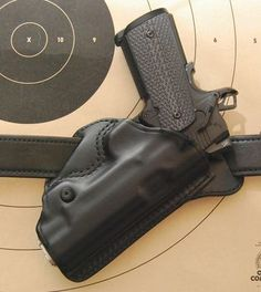 6 Ways to Carry a Gun Concealed (And the Holsters You Need), Notice how this Blackhawk! Check Six cants aggressively? That makes it easier to conceal. Concealed Carry Holsters, Gun Holster, Leather Holster, By Any Means Necessary, Cool Guns, Guns And Ammo, Tactical Gear, Tactical Holster, Tactical Knife