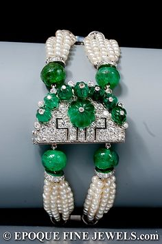 An unusual Art Deco tutti frutti emerald, seed pearl and diamond bracelet, a double multi strand seed pearl bracelet with diamond spacers and emerald beads, to the half moon diamond clasp set with carved emerald beads, mounted in platinum and gold. Circa 1925