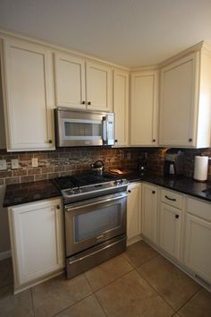 "Small Kitchen Remodels Design, Pictures, Remodel, Decor and Ideas - page 7.....I'm not sure how this classifies as a ""small kitchen"", but I love the backsplash!! :)"