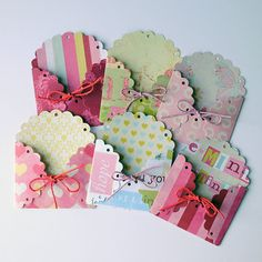 Each envelope has been die cut from a high quality cardstock and then tied with twine to accessorize it. The scalloped edge gives it that Oh So