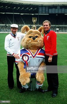 """circa The 1982 England World Cup mascot """"Bulldog Bobby"""" with the 1966 England World Cup heroes Bobby Moore, right and Bobby Charlton and the Jules Rimet trophy at Wembley Get premium, high resolution news photos at Getty Images 1982 World Cup, Fifa World Cup, Jules Rimet Trophy, Bobby Moore, Bobby Charlton, European Cup, Fa Cup, Best Player, Stock Pictures"""