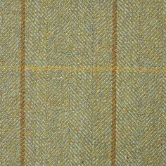 Forgue Saxony Tweed Fabric A hardwearing pure wool tweed fabric with a medium check of mocha and caramel woven on a olive green herringbone ground.