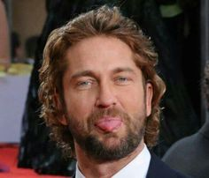 Dear Gerard Butler: Don't even attempt that stunt around me, Mister..... *Pounce!*