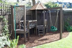 Playframe with rope bridge, play house, monkey bars, swing, fireman's pole