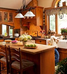 Love the arched window over the farmhouse sink, and the roomy island.