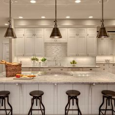 white kitchen...bronze lighting...match floor? Pendant lighting + can lights Love this--switch stove and sink and add a faucet for pasta
